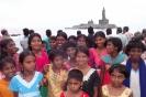 Girls and Thiruvalluvar statue